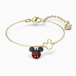Pulsera Swarovski, Mickey. Fabricada con cristales negros y rojos, y un baño de oro. 5566689. www.lubeljoyeria.com