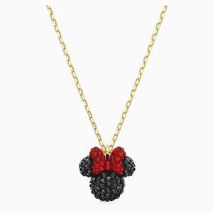 Colgante Swarovski, Minnie. Fabricado con cristales negros y rojos y un baño de oro. 5566693. www.lubeljoyeria.com